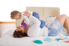 Mother and baby playing at home Royalty Free Stock Images