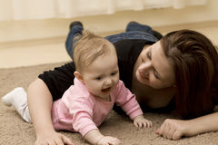 Mother and baby playing in home Stock Photography