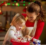 Mother and baby playing while making christmas cookies Royalty Free Stock Image