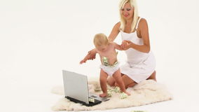 Mother And Baby Playing With Money And Laptop stock video footage