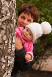 Mother and baby playing peek-a-boo Royalty Free Stock Photos