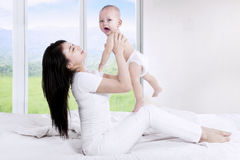 Mother and baby playing together Stock Photography