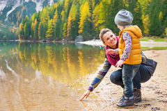 Mother and baby playing with water on lake braies. In south tyrol, italy stock photo