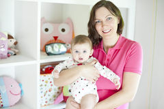 Mother and baby in playroom Royalty Free Stock Images