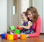 Mother and baby plays with toys Stock Image