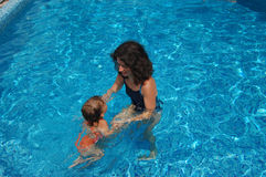 Mother and baby in the pool Royalty Free Stock Photo