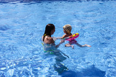 Mother and baby in the pool Royalty Free Stock Images