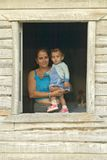Mother and baby posing in house window in the Valle de Vi�ales, in central Cuba Stock Image