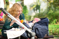 Mother with baby in pram Royalty Free Stock Photography