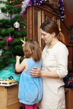 Mother and baby preparing for Christmas Royalty Free Stock Images