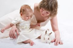 Mother and baby with rabbit Royalty Free Stock Image