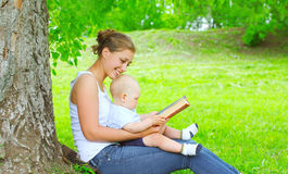 Mother and baby reading book together Stock Image