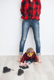 Mother and baby in red checkered shirts Royalty Free Stock Photo