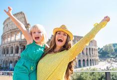 Mother and baby rejoicing in front of colosseum Royalty Free Stock Photography