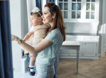 Mother and baby relaxing in a stylish interior Stock Photos