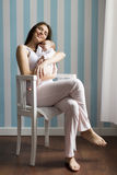 Mother and baby in the room Stock Images