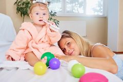 Mother with baby in the room. royalty free stock image