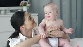 Mother with a baby at the room stock footage