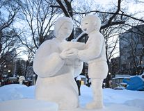 Mother and baby sculpture in Japanese snow festival Hokkaido Royalty Free Stock Photo