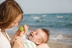 Mother and baby on sea background Stock Photography