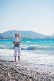 Mother with baby on sea coast Stock Photography