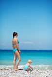 Mother and baby on sea shore Royalty Free Stock Photos
