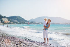 Mother and baby at sea shore looking on copy space Stock Image