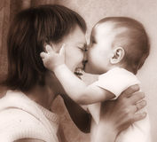 Mother and baby sepia tones stock photos