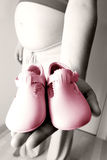 Mother and baby shoes Royalty Free Stock Image