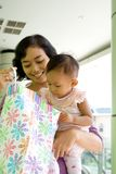 Mother and baby with shopping bag stock images