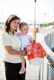 Mother with baby with shopping bags Royalty Free Stock Images