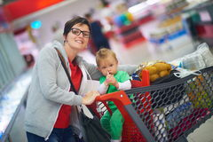 Mother with baby in shopping Stock Photo