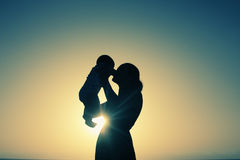 Mother and baby. Silhouette of mother and baby at sunset Royalty Free Stock Image