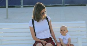 Mother And Baby Sitting On The Bench stock video footage