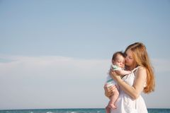 Mother and baby on sky background Royalty Free Stock Photo