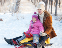 Mother with baby on sled Royalty Free Stock Photo