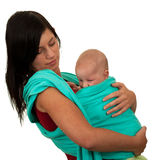 Mother with baby in sling Stock Photos