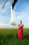 Mother and baby with sling on foregrou Royalty Free Stock Photography