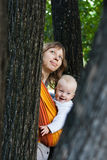 Mother with baby in a sling Royalty Free Stock Image