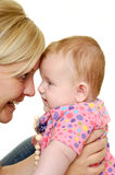 Mother and baby are smiling Stock Photo