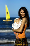 Mother and baby smiling on beach Royalty Free Stock Image