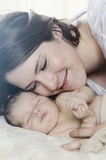 Mother and baby snuggle Royalty Free Stock Images
