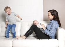 Mother with baby sofa Stock Photo