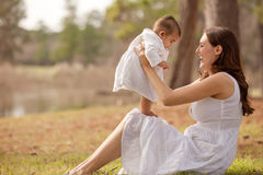 Mother and Baby Son First Steps Stock Image