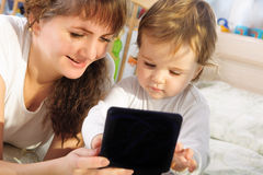 Mother and baby son playing with digital tablet Royalty Free Stock Photo