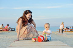 Mother and baby son. Playing toys near the sea Royalty Free Stock Images