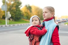 Mother with baby stay on crossroad Royalty Free Stock Photo