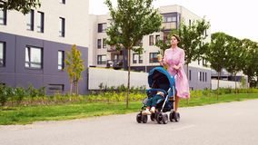 Mother with baby in stroller and coffee in city