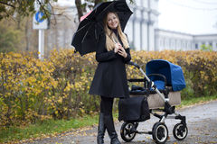 Mother with baby stroller for a newborn Stock Photos