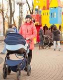 Mother with baby in stroller Stock Image